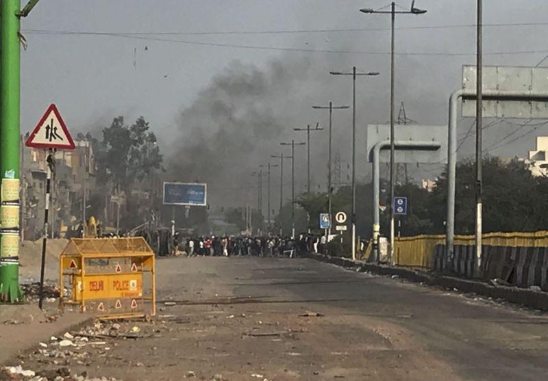 Delhi burns as Indian PM Modi hosts Donald Trump